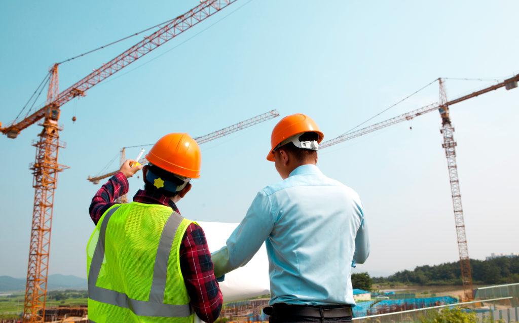 construction workers surveying the land