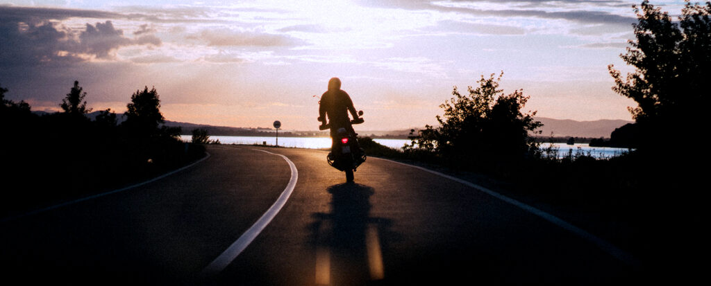motorcycle on road during sunset
